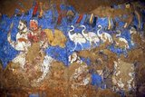 The Afrasiab painting is a rare example of Sogdian art. It was discovered in 1965 when the local authorities decided on the construction of a road through the middle of Afrāsiāb mound, the old site of pre-Mongol Samarkand. It is now preserved in a special museum on the Afrāsiāb mound. It is the main painting we have of ancient Sogdian art.<br/><br/>  The painting dates back to the middle of the 7th century CE. On the four walls of the room of a private house, three or four different countries neighbouring Central Asia are depicted. On the northern wall China (a Chinese festival, with the Empress on a boat, and the Emperor hunting), on the Southern Wall Samarkand (the Iranian world: a religious funerary procession in honor of the ancestors during the Nowruz festival), on the eastern wall India (as the land of the astrologers and of the pygmies, but the painting is much destroyed there).<br/><br/>  The topic on the main wall, the western wall facing the entrance is debated between specialists. Turkish soldiers are escorting ambassadors coming from various countries of the world (Korea, China, Iranian principalities, etc). There are three main hypotheses. The leading expert on Sogdian painting, the excavator of Panjikent, B. Marshak points out that Sogdian painting, gods are always depicted on the top of the main wall. However, as the Turks are guiding the embassies but are not themselves ambassadors, it has been suggested also that the Turkish Qaghan, then lord of inner and central Asia, might be depicted there.<br/><br/>  A Chinese text states that  the 'Four Lords of the World', here China, India, Iran and Turan, are depicted on the walls of palaces near Samarkand precisely during this period, and this would perfectly fit the four walls of this room. The last hypothesis makes use of an inscription mentioning the king of Samarkand to propose the idea that the ambassadors are presenting their gifts to him.